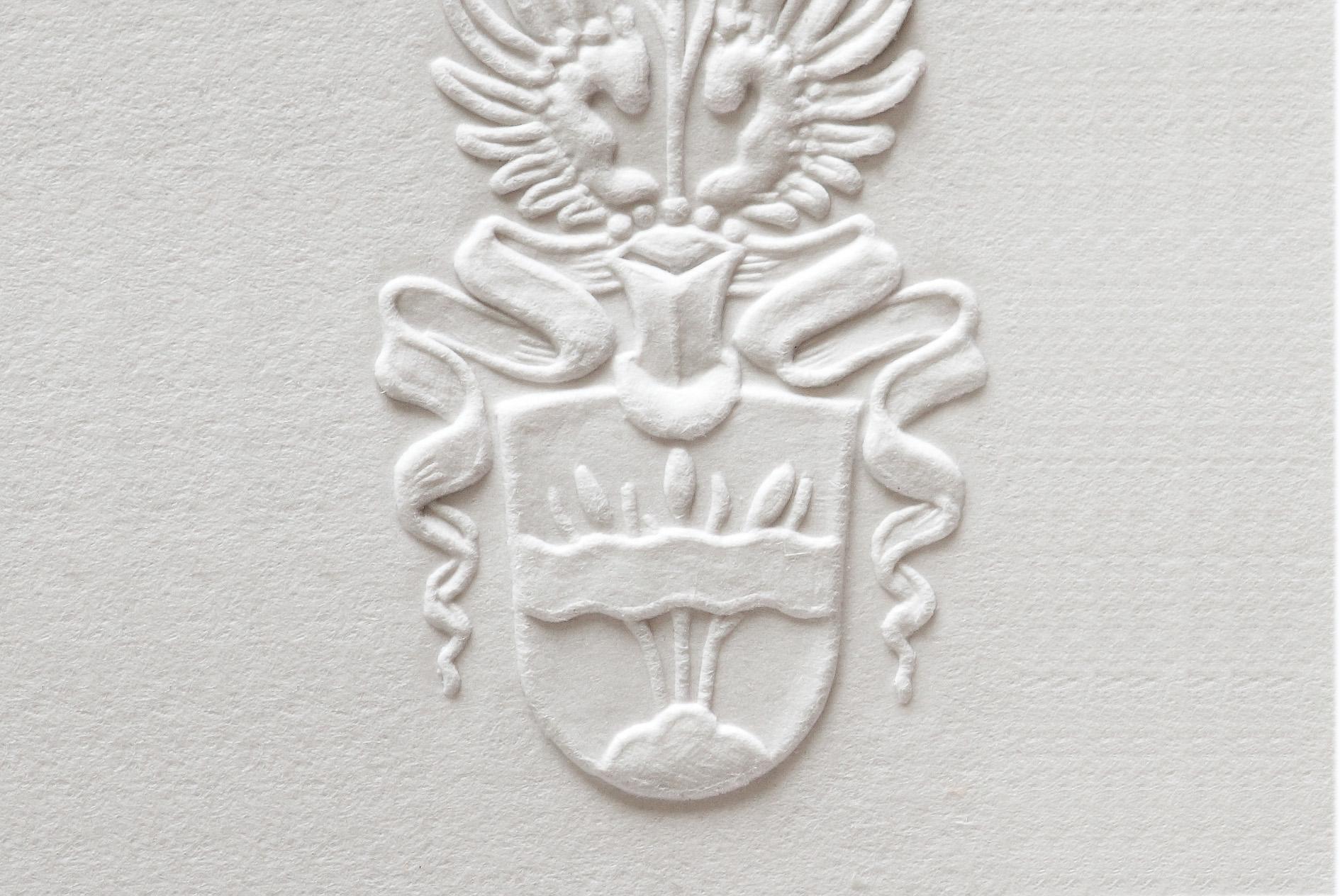 Blindprägung_Wappen+Flügel
