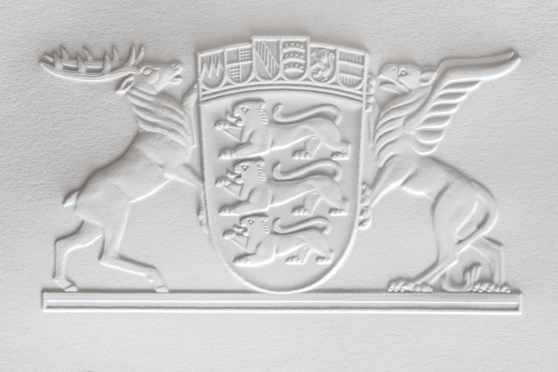 Blindprägung_Wappen Hirsch+Adler